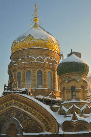 Winter view snow-covered dome of Church of metochion of Optina monastery in Saint Petersburg, Russia
