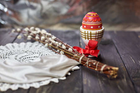 Easter still life with souvenir egg on wooden table