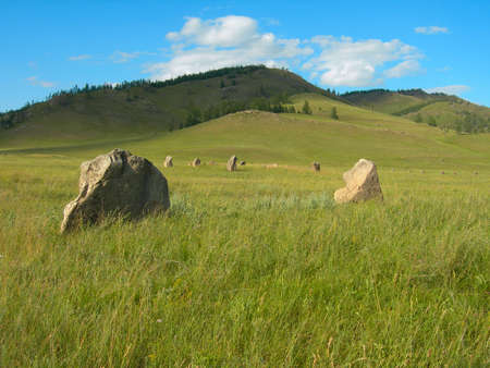Ancient pagan burials in the steppes of Khakassia, Russia, Siberia. Authentic Khakassky menhirs. 스톡 콘텐츠 - 97294035