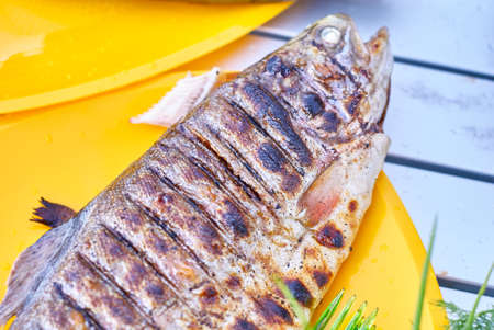 Fried fish grill on the table close up