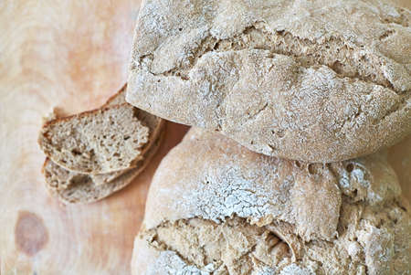 Homemade freshly baked bread on wooden table closeup 写真素材