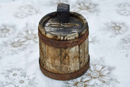 Old smudgy wooden barrel for fuel oil closeup