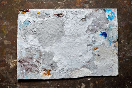Dirty dried artist palette with paint blots and stains from above 스톡 콘텐츠