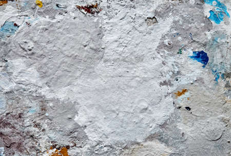 Dirty artist palette with dried paint close up 写真素材