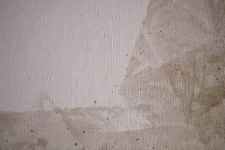 Grunge background canvas with brown paint stains and roller traces closeup 스톡 콘텐츠