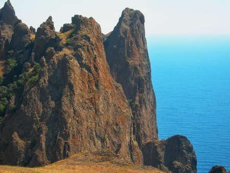 Sunlit mountain and sea Stok Fotoğraf