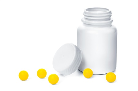 Open plastic medical container with yellow vitamins Stock Photo