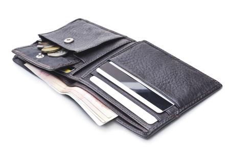 Open brown leather wallet with money  photo