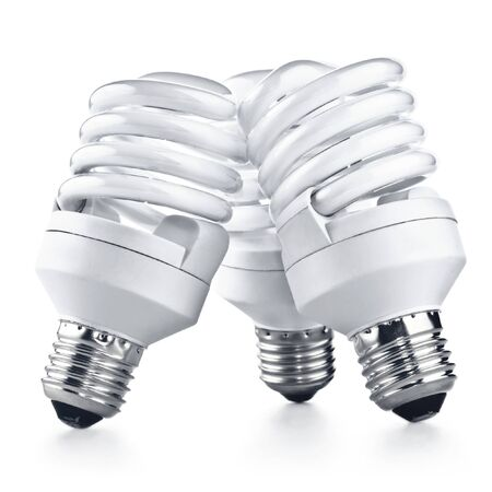 Energy saving fluorescent light bulb on white bakground photo