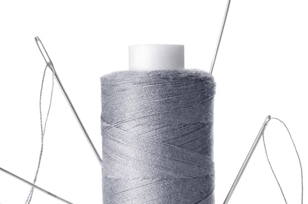 A few needles in the spool of thread Stock Photo