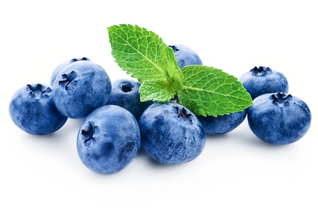 Fresh blueberry with green leafs of mint on white background