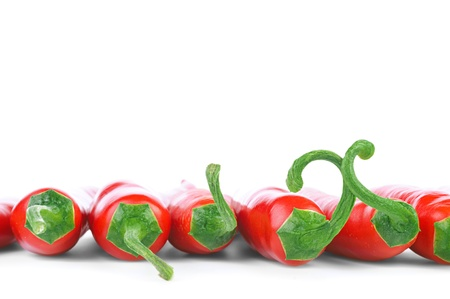 Row of ripe red hot chili peppers