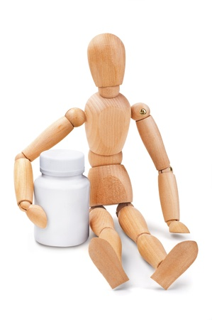 Wooden man embracing medical container
