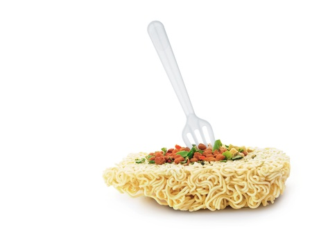Uncooked fast food vermicelli with fork  Stock Photo