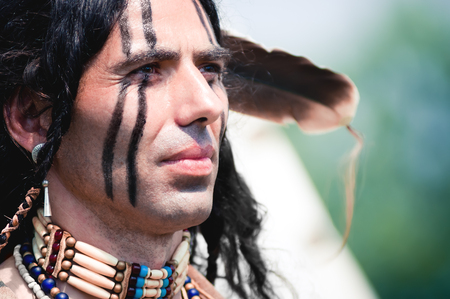 native american indian: Portrait of american indian in national dress Stock Photo