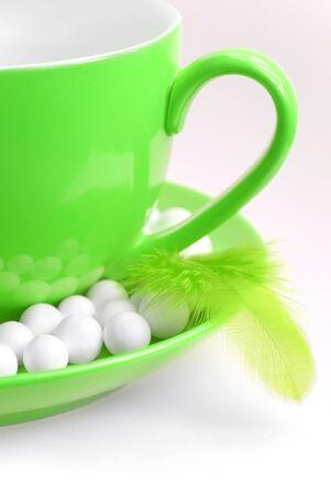 Green coffee mug with feather
