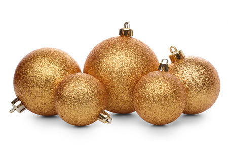 Group of golden christmas balls isolated on white background
