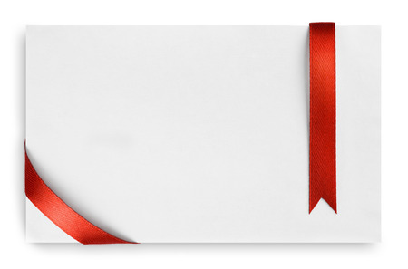 Red silk ribbon on empty paper card Stock Photo