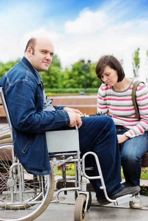 invalidity: Man in wheelchair with his girlfriend