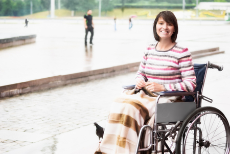 outdoor chair: Smiling woman in a wheelchair