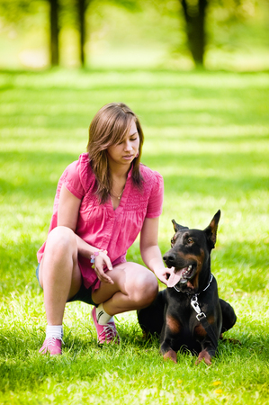 Young beautiful girl with a dog Stock Photo