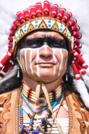 Portrait of american indian chief in national dress