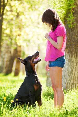 black dog: Young beautiful girl with a dog Stock Photo