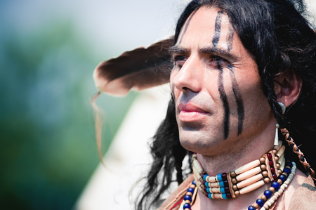 american native: Portrait of american indian in national dress Stock Photo