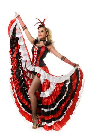 Hermosa muchacha sonriente está aislado bailando flamenco en el fondo blanco Foto de archivo