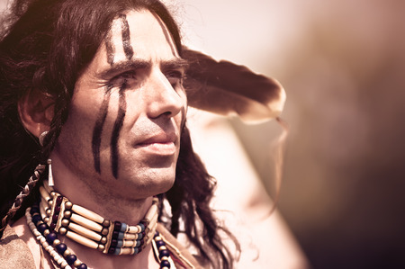 indians: Portrait of american indian in national dress Stock Photo