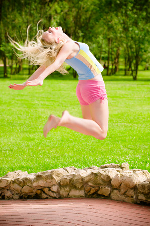 emotional freedom: Happy girl jumping in park