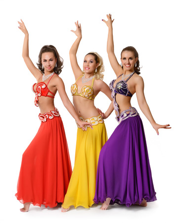 Group ofl belly dancers with multicolor shawl isolated on white background