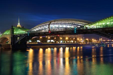 embankment: The pedestrian bridge Bogdan Khmelnitsky on night. Moscow cityscape, Russia