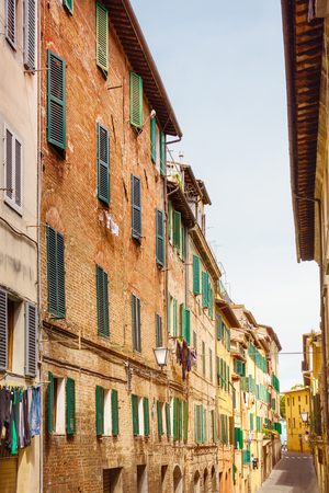 sienna: Small town street view in Sienna, Italy Stock Photo