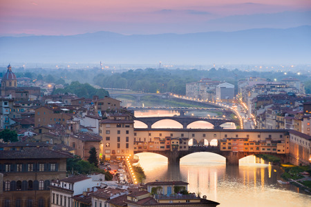 arno: Colorful sunset over Ponte Vecchio on Arno River, Florence, Italy Stock Photo