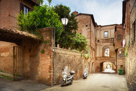 old building facade: Small town street view in Sienna, Italy Stock Photo