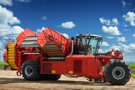 harvester: Potato harvester machine on the field