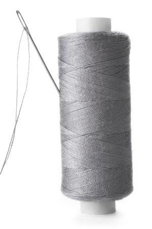spool: A needle in a spool of thread Stock Photo
