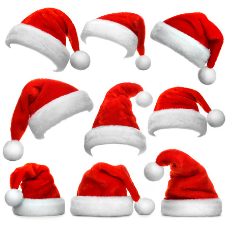 Set of red Santa Claus hats isolated on white background Foto de archivo