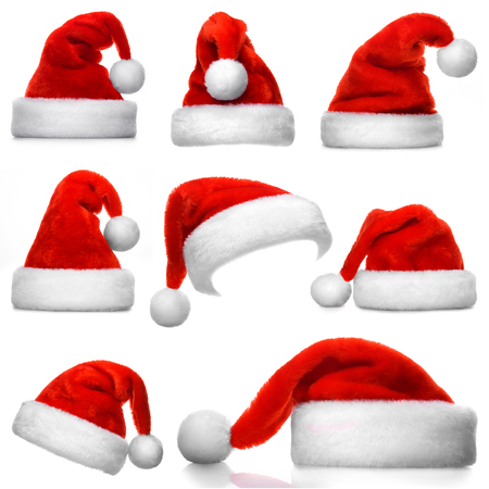 wearing santa hat: Set of red Santa Claus hats isolated on white background Stock Photo