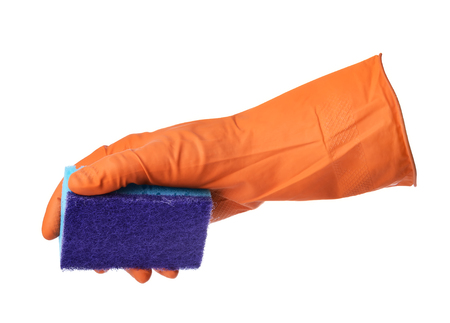 empleadas domesticas: Hand with orange rubber glove holds blue sponge isolated on white background