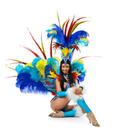 Smiling beautiful girl in a colorful carnival costume