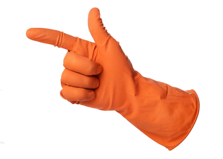 empleadas domesticas: Hand with orange rubber glove is pointing on isolated on white background