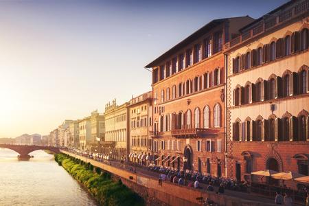 trinita: Ponte Santa Trinita medieval Bridge on Arno river. Colorful sunset , Florence, Italy
