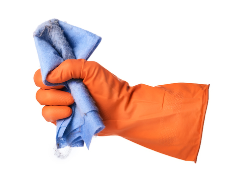 cloths: Hand with orange rubber glove holds blue ditry cloth isolated on white background Stock Photo