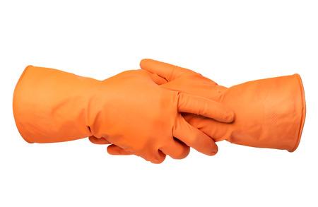empleadas domesticas: Dos manos con guantes de goma de color naranja aisladas sobre fondo blanco Foto de archivo