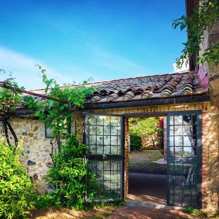 barn door: Traditional Italian villa, Tuscany, Italy Stock Photo