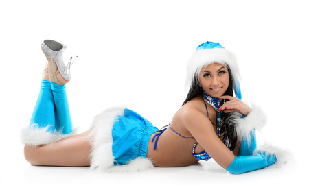 Cute sexy girl in blue christmas costume isolated on white background