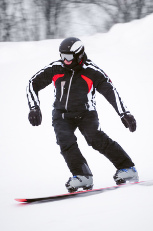 Teen snowboarder in black costume