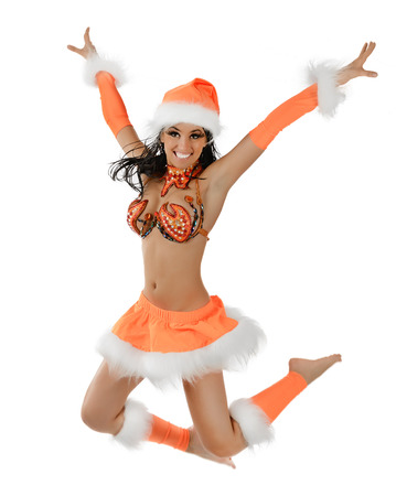 Cute sexy girl in christmas costume jumping isolated on white background